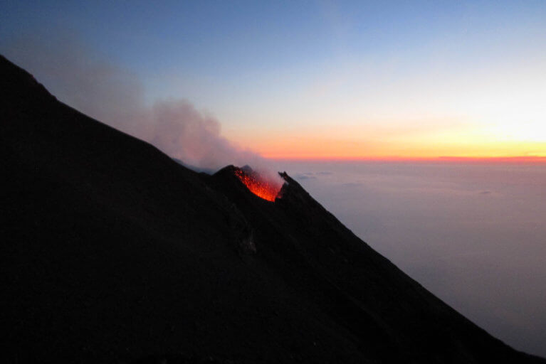 Stromboli volcano erupting in the evening during private Sicily tour