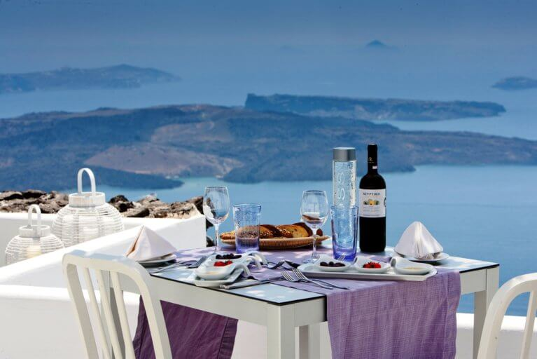 Gourmet lunch al fresco with a view of the sea in Santorini