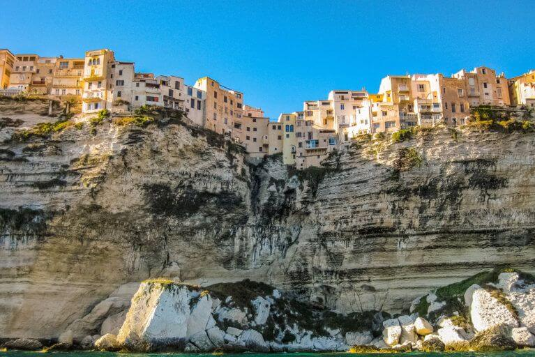 Looking up at town of Bonifacio and cliffs from the sea during a luxury Corsica tour