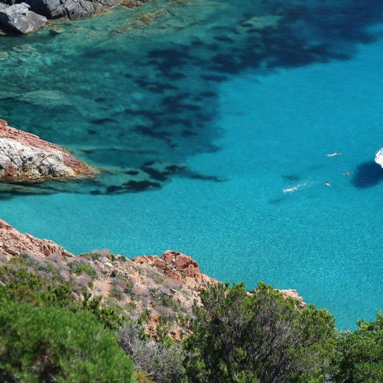 aerial view of luxury yacht in blue sea during luxury corsica trip