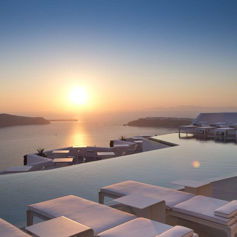 infinity pool at sunset with sea views during luxury greece tour